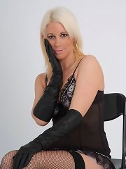 Leather gloves on this blondes soft skin just drives her wild