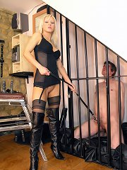 Mistress tormented the caged man