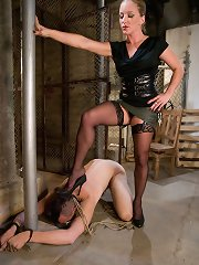 Superlative dunce dominatrix hobbles dogboy and reams him in the ass with her fist