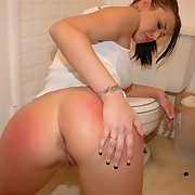 Young chick got spanked at a catch end of one's tether her Mistress in a catch kitchen