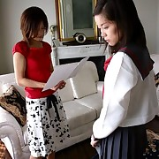 Young Japanese schoolgirls practicing hardcore OTK spanking at home