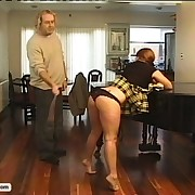 Sexy redhead wench in punished with the cane