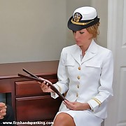 Enticing naval cadet Elli Harrison bares their way bottom for a 50-stroke strapping