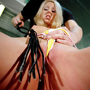 Nicole's opened pussy got a lot of whipping punishment.