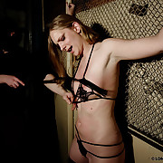 Punished tied Bianca readily obtainable a lattice frame close to a downcast black lingerie.