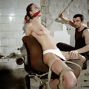 Bandaged and gagged Amy got breast and stomach caning!