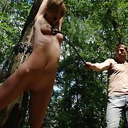 Amy was whipped an unusual way in the forest.