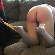 Lewd doll has stern spanks on her prat