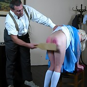 A blonde maid was punished by wooden paddle