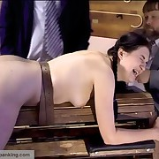 Tied down to a penalty bank for getting her bottom spanked black and blue