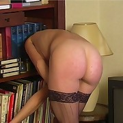 Pretty angel in nylons acquires a shameful spanking on her bared buttocks