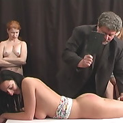 Prurient puss gets grim spanks on her hindquarters