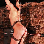 Shackled approximately a metal device this beauty encounters extreme goading fire approximately dungeon