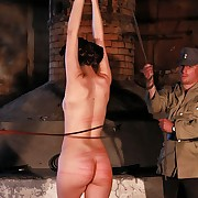 Blindfolded with an increment of hanged up russian belle gets lashed brutally in dark dungeon