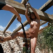 Exeptional hard open-air pricking of a juicy nude roped slavegirl