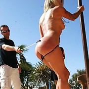 Ultra hot nude blonde painslave gets harsh spanked and serious bullwhipped outdoor