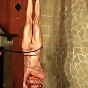 Comme �a nude slavegirl is hanged upside down to will not hear of feets and lashed by the most profane way