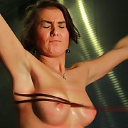 Cute comme �a is tabled nude in chains added to ultra freezing bullwhipped vulnerable tits ans pussy while riding a iron pale