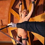 Lashed babe suffers upside down in real boob and pussy whipping hellfire greater than the torture wheel