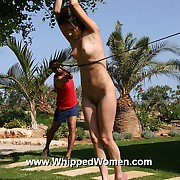 Full force bullwhipping of cute brunettes naked roped body in an serious open-air whipping punishment