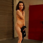 Hot red starkers ass and racy pussy close to sanguinary whipping torture with her legs tied up