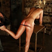 Blonde babe is hanged by ropes with an increment of serious lashed on will not hear of botheration with an increment of back in dungeon