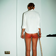 Cute teen alongside the corner with brutally caned bottom - severe stripes and welts