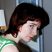 Beautiful redhead girl is taken OTK of a sound paddling on the brush defoliated bottom