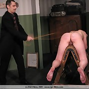 Bottom caned coupled with pussy strapped