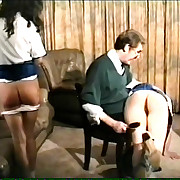 Two young schoolgirls caned hard on their stunning naked asses