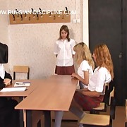 Georgious girl is severely paddled over a chiffonier in the classroom