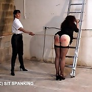 Big buxom ass gets paddled and caned in the Men's Room - piercing punishments