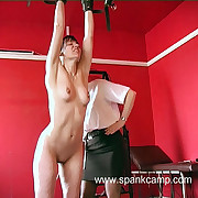 Naked and restrained girl gets her firm ripe submissive blistered with hammer away sculler