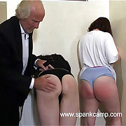 Shower region punishments - two girls strapped on their stained tushie with leather tawse