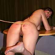 Sensitive caning for unshod girl bent across chum around with annoy cabinet with reference to pain