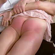 She has her bottom spanked brutally
