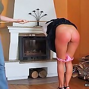 Girl in mini skirt receives her red arse caned