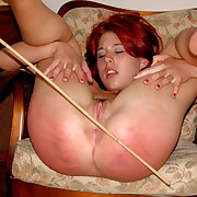 Filthy whore spreads her ass cheeks wide for a roasting flogging