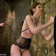 Pain slut sucks penis to orgasm below a whip!