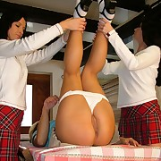 Two schoolgirls spanking one
