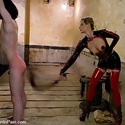 A latex goddes facesits and flogs a slaveman