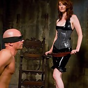 Gorgeous latex femdom-goddess Kendra beats villein chap to his restrictions and violates his ass