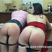 Two bitches spanked on the table