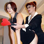 Cruel mistress trounces her lesbian sub