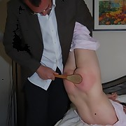 A severe spanking with the scrubbing brush on her nude ass