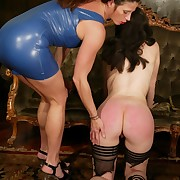 Mistress in latex torture and spanking slavegirl