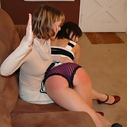 Salacious chick gets pitiless spanks on her glutes