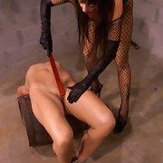 Busty pro domme flogging slavegirl