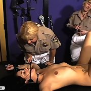 Two blondes in uniform chastise nasty schoolgirl