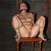 Bound to a chair, that babe comes intense and long, her face moist with cum.